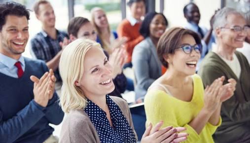 audience applauding the spaeaker