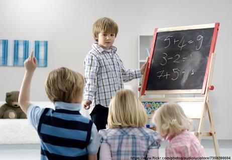 Kid teaching others maths
