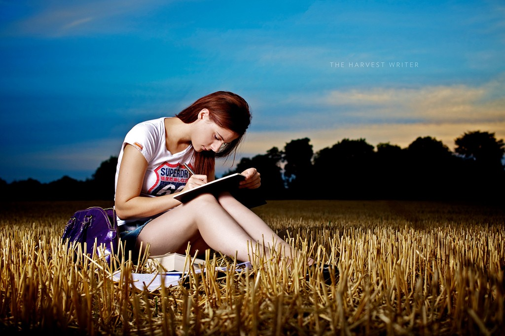 woman writing in the bush