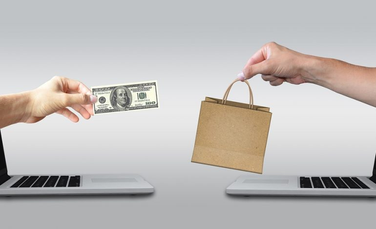 two hands out from computer to exchange goods and money