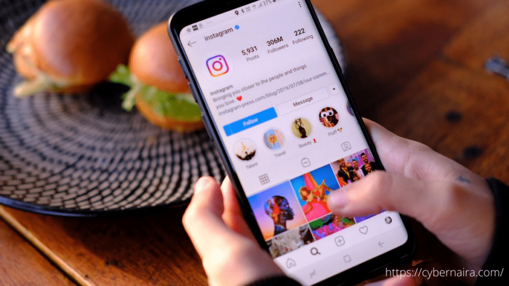 A man holding a smartphone with Instagram app opened on it